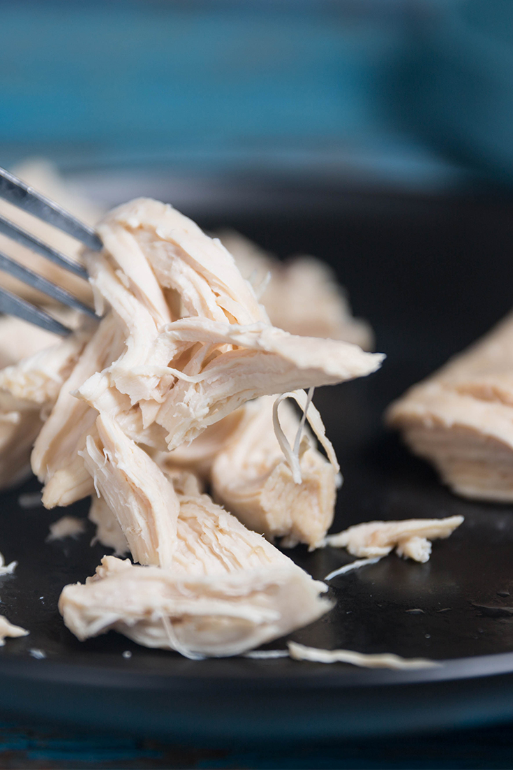 How to shred chicken using two forks.