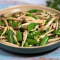 Easy Chinese sweet and spicy mushroom stir fry with peas and green onions! a great weeknight meal.